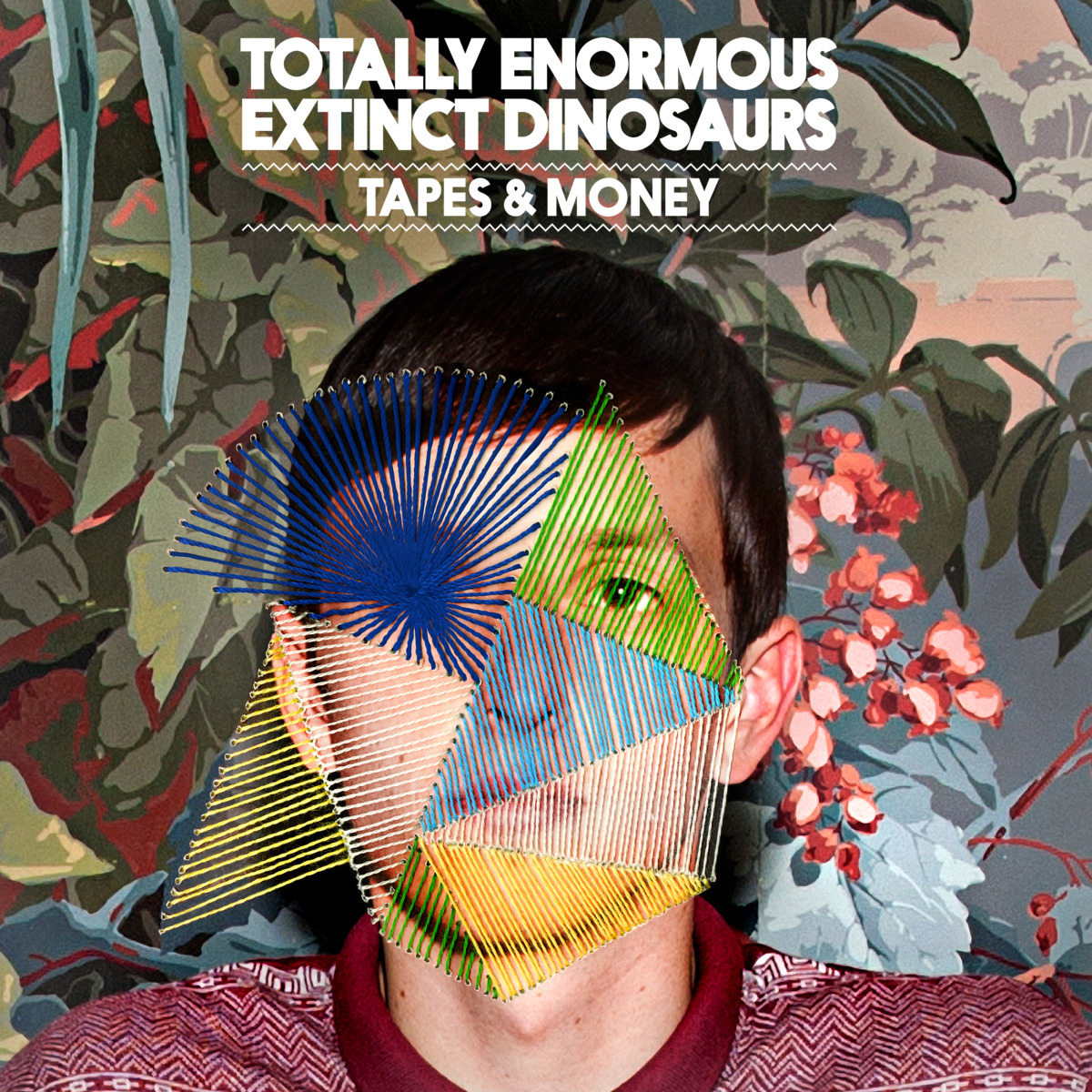 "Music / Totally Enormous Extinct Dinosaurs<span class=""slide_numbers""><span class=""slide_number"">4</span>/5</span>"